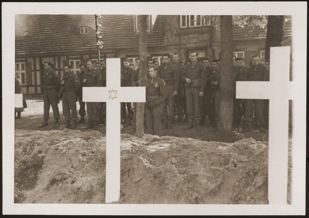 "<p>After the <a href=""/narrative/2317"">liberation</a> of the camp, the US Army ordered the local townspeople to bury the corpses of prisoners killed in the camp. This photograph shows troops observing a moment of silence at a mass funeral for victims of the <a href=""/narrative/7988"">Wöbbelin</a> camp. Germany, May 7, 1945.</p>"