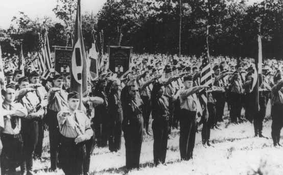 <p>Members of the pro-Nazi German American Bund and the pro-Fascist Italian Blackshirts give the Nazi salute. This gathering took place at the Bund's Camp Siegfried on Long Island. Yaphank, New York, United States, October 16, 1937.</p>