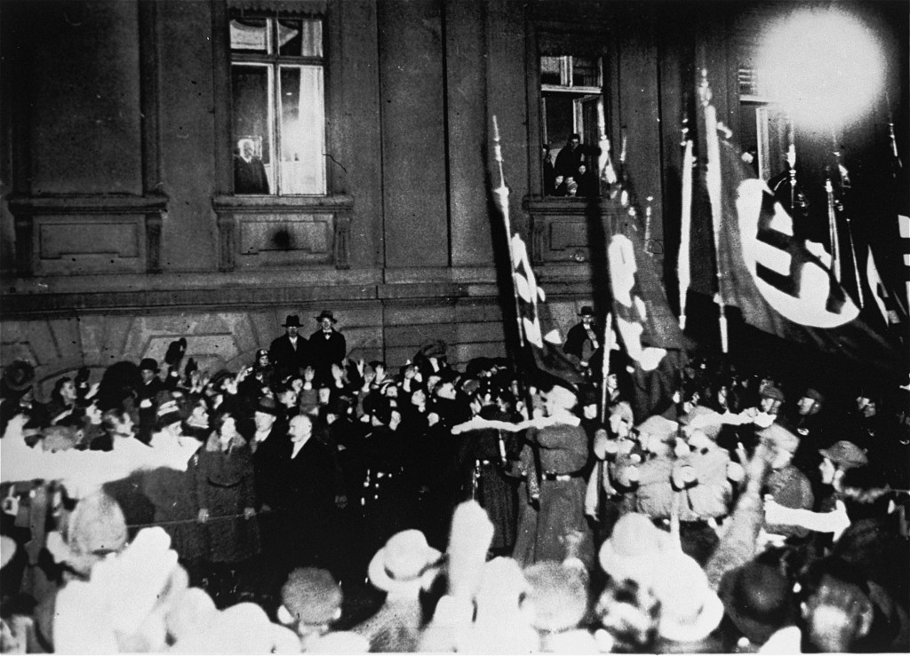 From a window in the Reich Chancellery, German president Paul von Hindenburg watches a Nazi torchlight parade in honor of Hitler's ... [LCID: 78583]