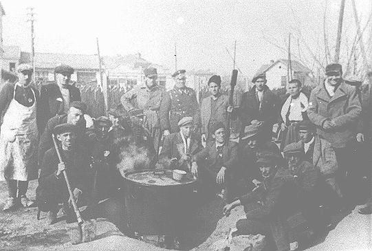 "<p>Jews prepare soup outside the Monopol tobacco factory, used as a transit camp by Bulgarian authorities during deportations of Jews from Macedonia. Skopje, <a href=""/narrative/6153"">Yugoslavia</a>, March 1943.</p>
