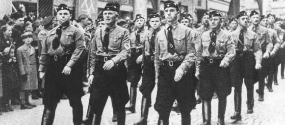 <p>Members of the Hlinka Guard and a squad of ethnic Germans march during a parade in Slovakia, a Nazi satellite state. Date uncertain.</p>