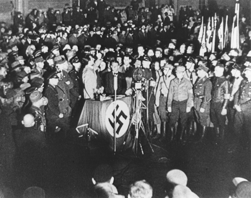 Propaganda Minister Joseph Goebbels (at podium) praises students and members of the SA for their efforts to destroy books deemed ... [LCID: 85339b]