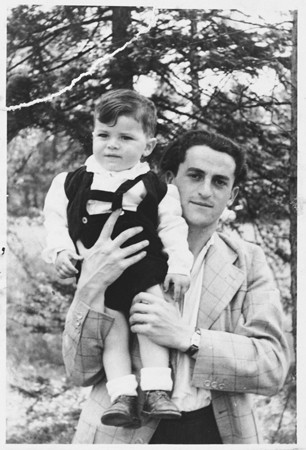 <p>Josef Baldo, formerly a Bielski partisan, poses with his young son. Foehrenwald, Germany, ca. 1945.</p>