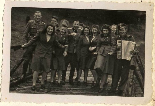 <p>SS female auxiliaries (Helferinnen) run down a ramp in Solahütte to the music of an accordion.</p>