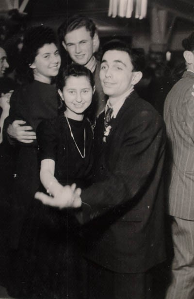 <p>Regina (top, left) with friends at a dance in Berlin. Germany, December 26, 1946.</p>