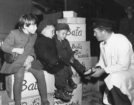 Jewish orphans fleeing Europe are fitted with shoes from the United Nations Relief and Rehabilitation Administration (UNRRA), en route to Allied occupation zones in Germany and Austria.