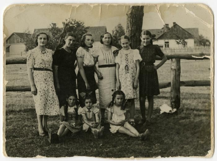 Group portrait of women and children standing outside in Warsaw before the war.