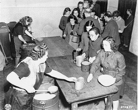 <p>Hot food is served at the displaced persons camp on Arzbergerstrasse. Vienna, Austria, March 1946.</p>