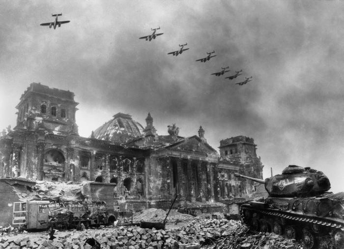 Soviet planes fly over the destroyed Reichstag building in Berlin.