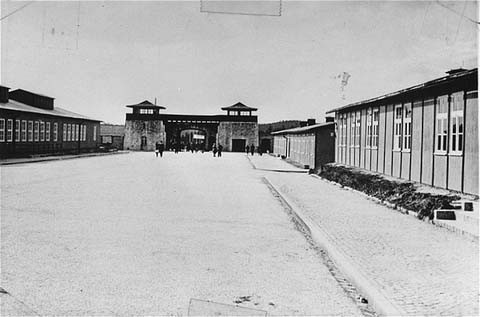 """<p>The roll call square in the <a href=""""/narrative/3880/en"""">Mauthausen</a> concentration camp, looking toward the main gate. This photograph was taken after the liberation of the camp. Mauthausen, <a href=""""/narrative/5815/en"""">Austria</a>, between May and September, 1945.</p>"""