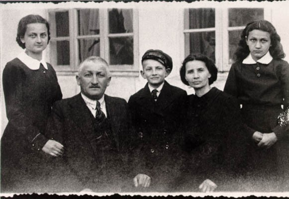 "<p><a href=""/narrative/10366"">Lisa Nussbaum</a> and her family. From left to right: Pola (sister), Herschel (father), Borushek (brother) Gittel (mother), and Lisa (about 13 years old in this photograph). Lisa's father exported geese to Germany for a living. Photograph taken in Raczki, Poland, ca. 1939.</p>