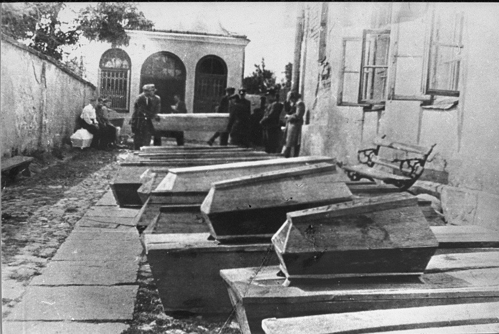 Coffins containing bodies of Jews killed in the Kielce pogrom. [LCID: 63688b]