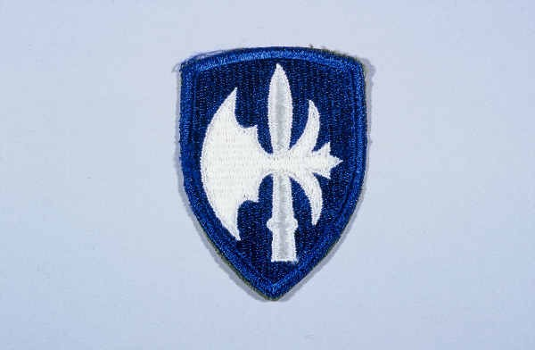 """Insignia of the 65th Infantry Division. The 65th Infantry Division was nicknamed the """"Battle Axe"""" after the divisional insignia, ... [LCID: n05640]"""