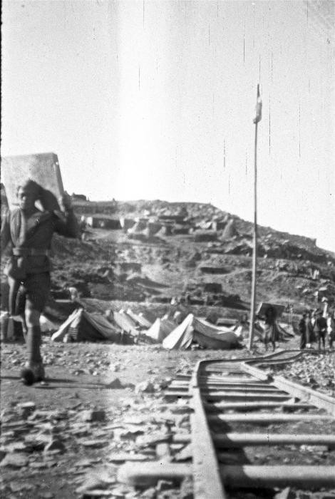 <p>An unidentified worker walks by the railroad tracks at the Im Fout labor camp in Morocco. Living conditions were harsh in the camp, and many of the workers fell ill with typhus. Im Fout, Morocco, 1941-42.</p>