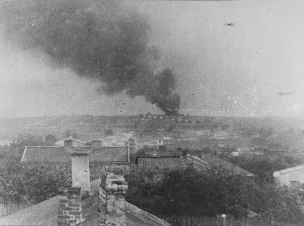 View of Majdanek camp from a nearby village. The smoke could be from the burning of corpses. [LCID: 83854]