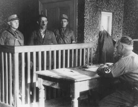 <p>Members of the SA interrogate a newly arrived prisoner in the Oranienburg camp near Berlin. Germany, April 21, 1933.</p>