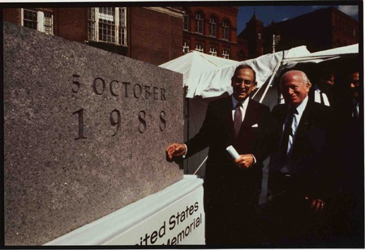 """<p><a href=""""/narrative/10553"""">Benjamin Meed</a> (right) and Harvey Meyerhoff stand next to the cornerstone for the United States Holocaust Memorial Museum. In October 1988, President Ronald Reagan spoke at a special ceremony held when the cornerstone of the Museum was laid, with construction beginning in July 1989 and ending in April 1993. Washington, DC, 1988.</p>"""