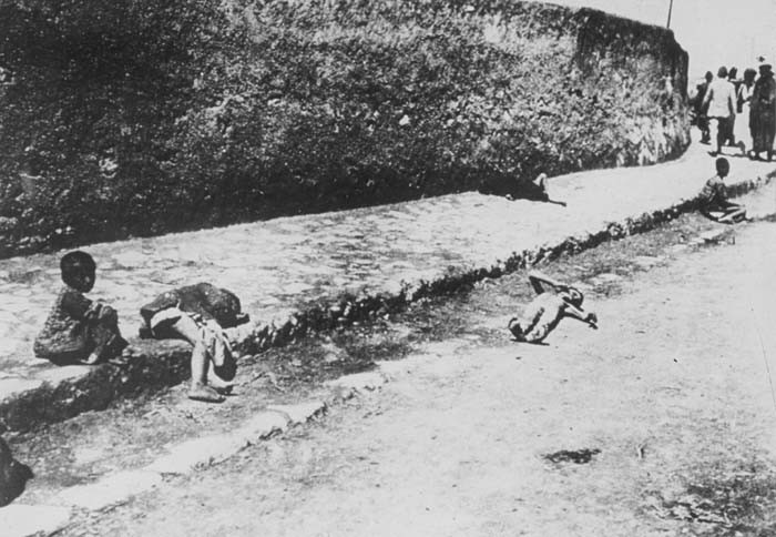 Armenian children lie in the street of an unidentified town. [LCID: 68684]