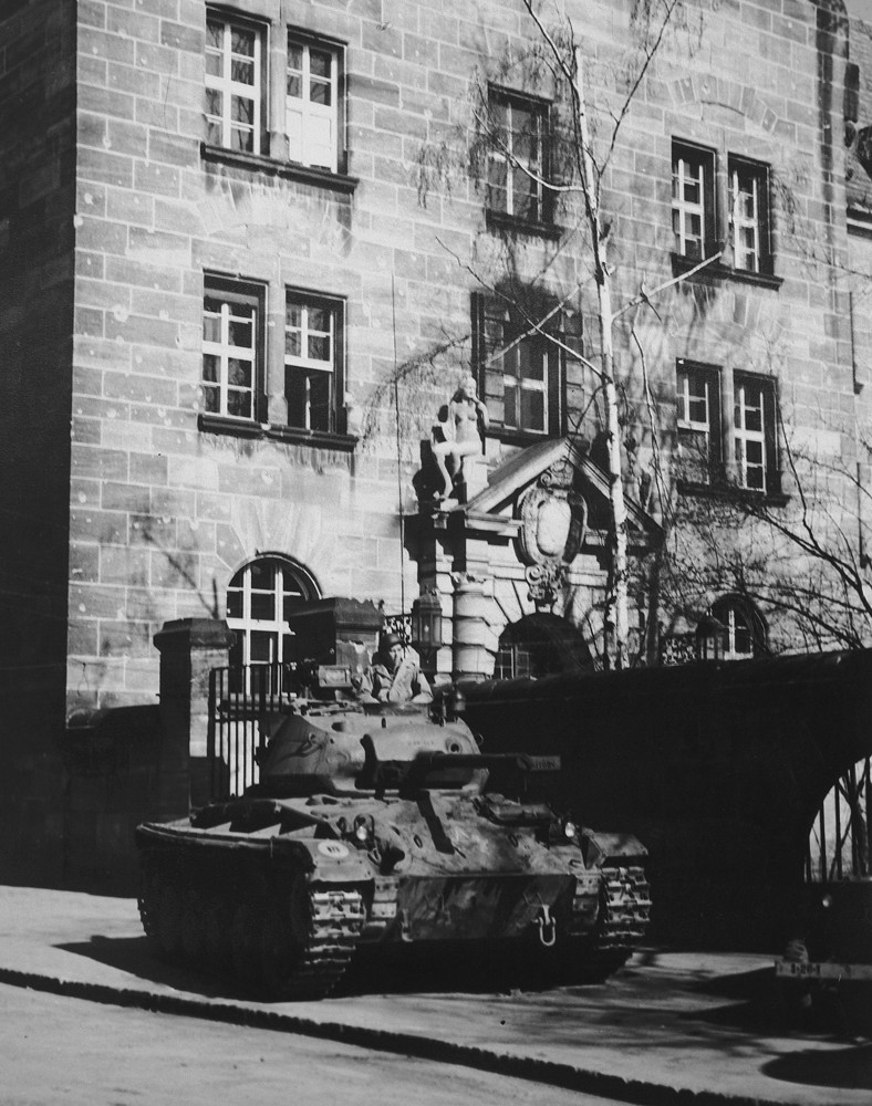 A tank guards the entrance to the Palace of Justice in Nuremberg. [LCID: 56292]