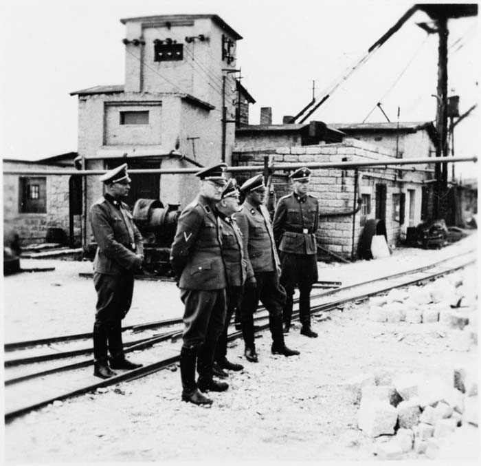 Commandant Arthur Roedl and SS officers visit the Gross-Rosen concentration camp's quarry. [LCID: 36223]