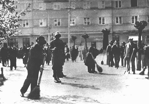Hungarian gendarmes oversee a group of Jewish forced laborers.