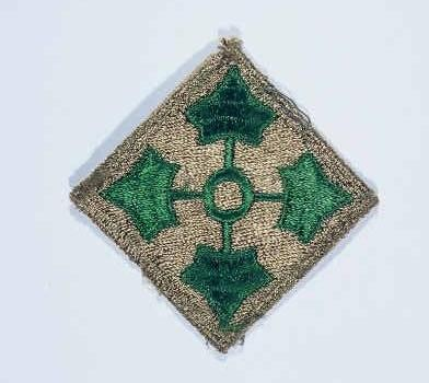 """Insignia of the 4th Infantry Division. The 4th Infantry Division's nickname, the """"Ivy"""" division, is derived from the divisional insignia ... [LCID: n05624]"""