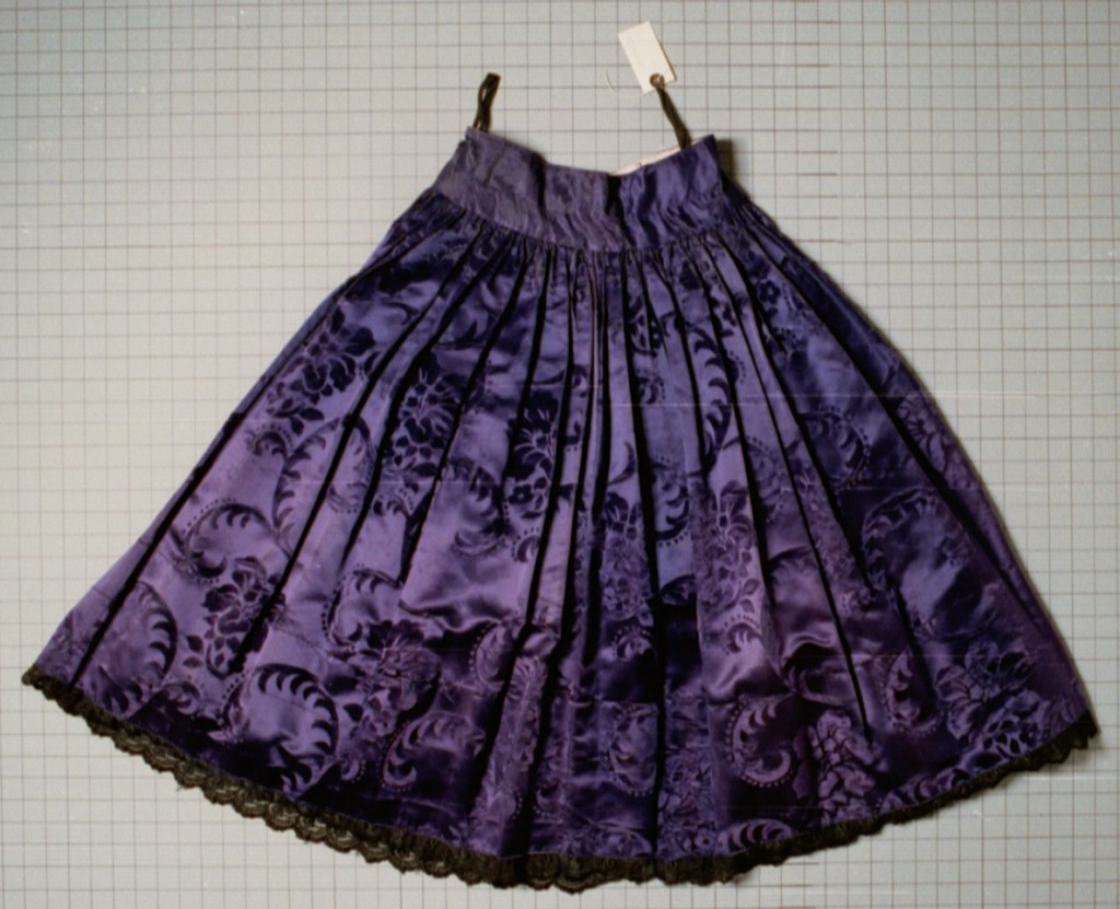 """<p>This taffeta and cotton skirt dates from the 1920s. It belonged to a Romani (Gypsy) woman who was born in Frankfurt, Germany, and who lived in Germany before the war. She was arrested by the Nazis and interned in the <a href=""""/narrative/3673/en"""">Auschwitz</a>, <a href=""""/narrative/4015/en"""">Ravensbrück</a>, <a href=""""/narrative/3880/en"""">Mauthausen</a>, and <a href=""""/narrative/4549/en"""">Bergen-Belsen</a> camps. She died in <a href=""""/narrative/4549/en"""">Bergen-Belsen</a> in March 1945, shortly before the camp's liberation. Her husband and two of her six children were also killed in the camps.</p>"""