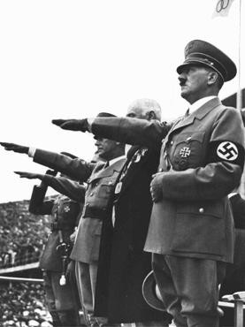 Adolf Hitler salutes the Olympic flag at the opening of the Olympic Games in Berlin. [LCID: 73495]