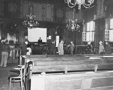 <p>The courtroom in the Palace of Justice, chosen as the location for the International Military Tribunal trial of war criminals. This photograph shows the courtroom before any repairs or alterations were made. Nuremberg, Germany, August-September 1945.</p>