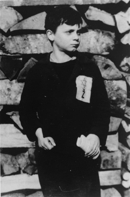 "A Jewish child wears the compulsory Star of David badge with the letter ""Z"" for Zidov, the Croatian word for Jew. [LCID: 68289a]"