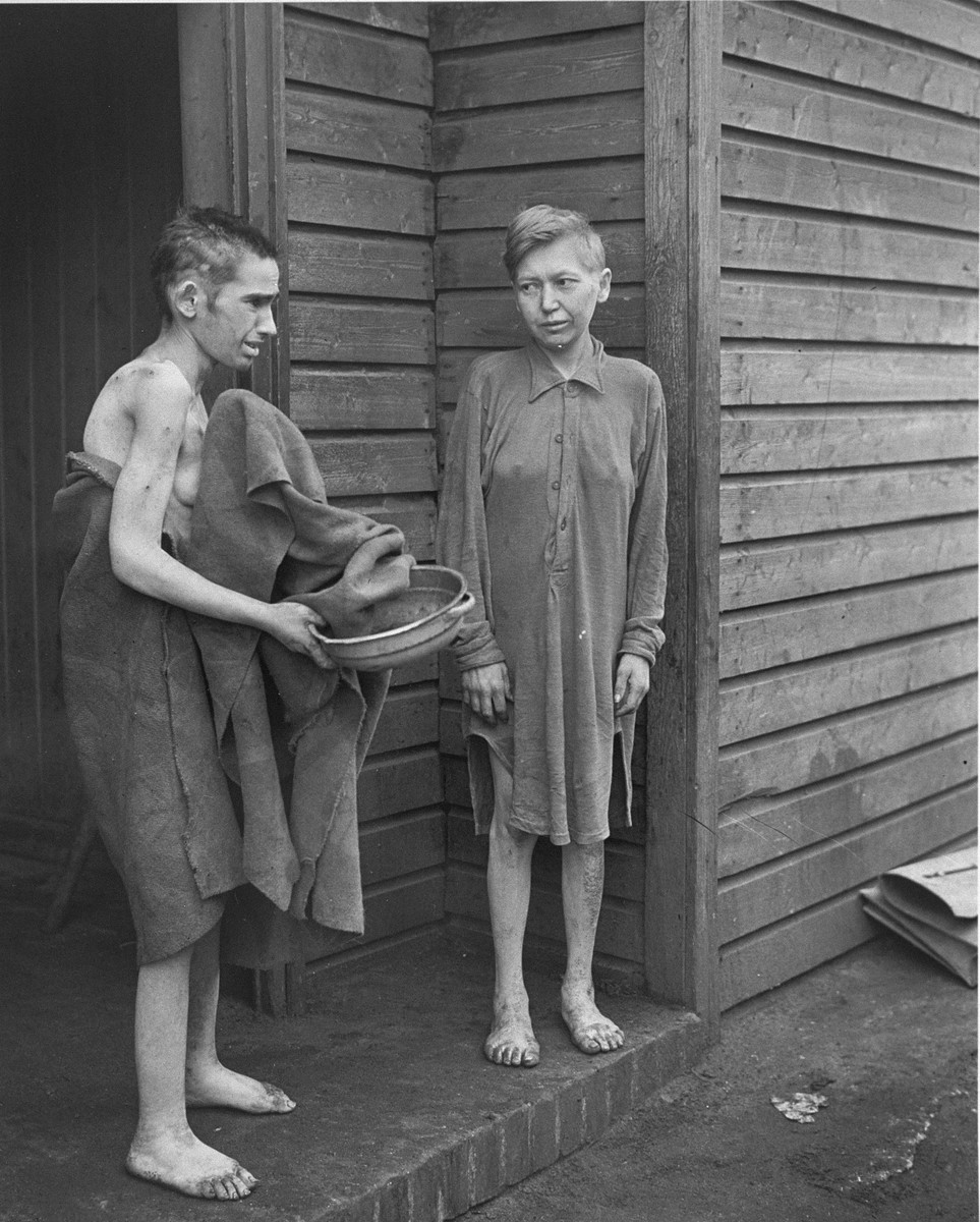 Two survivors in front of the women's barracks in the Bergen-Belsen concentration camp.