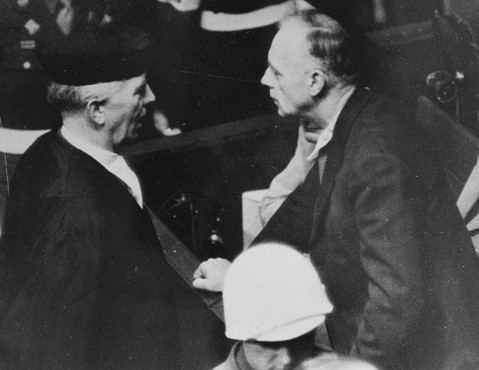 <p>Joachim von Ribbentrop (Foreign Minister of Germany from 1938 to 1945) speaks with his lawyer, Dr. Fritz Sauter, in the Nuremberg courtroom.</p>