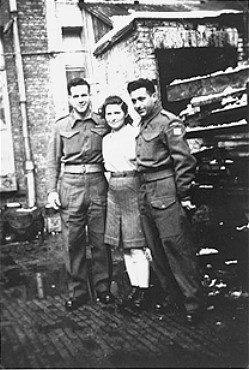 "A Jewish Brigade soldier with two members of ""Kibbutz Buchenwald,"" a group of survivors from the Buchenwald concentration camp preparing ... [LCID: 02274]"
