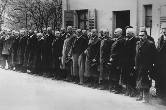 "<p>Jews arrested after Kristallnacht (the ""Night of Broken Glass"") await deportation to Dachau concentration camp. Baden-Baden, Germany, November 10, 1938.</p>"