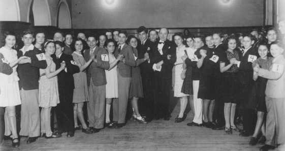 <p>Lessons in dancing and etiquette were given in the Shanghai Jewish Youth Association (SJYA), a school for Jewish refugee children who escaped to Shanghai. China, 1940.</p>