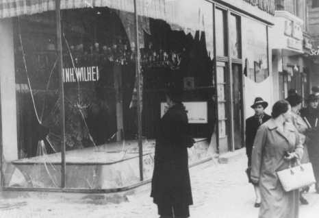 "Jewish-owned shop destroyed during Kristallnacht (the ""Night of Broken Glass""). [LCID: 50378]"