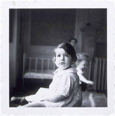 A young girl in a home for Jewish infants waiting for their families to claim them or be adopted. [LCID: 71594]