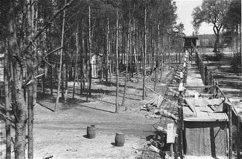 "<p>The fenced perimeter and an entrance to the women's camp at <a href=""/narrative/7988"">Wöbbelin</a>. Photograph taken May 4–6, 1945.</p>"