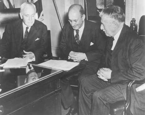 Photo taken in Secretary of State Cordell Hull's office on the occasion of the third meeting of the War Refugee Board. [LCID: 85938]