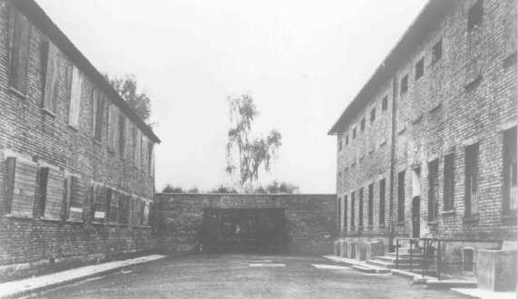 "<p>The Black Wall, between Block 10 (left) and Block 11 (right) in the <a href=""/narrative/3673"">Auschwitz</a> concentration camp, where executions of inmates took place. Poland, date unknown.</p>"