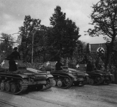 <p>German tanks pass a reviewing stand during a victory parade following the German defeat of Poland. Warsaw, Poland, October 5, 1939.</p>