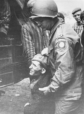 "<p>A chaplain with the <a href=""/narrative/7977"">82nd Airborne Division</a> helps a survivor board a truck that will evacuate him from the Wöbbelin concentration camp to an American field hospital. Germany, May 4, 1945.</p>"