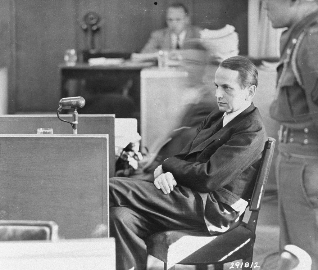 "<p>Defendant Otto Ohlendorf testifies on his own behalf at the Einsatzgruppen Trial, <a href=""/narrative/9545"">case #9</a> of the Subsequent Nuremberg Proceedings. October 9, 1947.</p>"