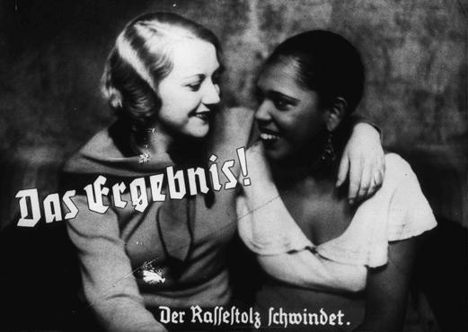 "<p>Nazi propaganda photo depicts friendship between an ""Aryan"" and a black woman. The caption states: ""The result! A loss of racial pride."" Germany, prewar.</p>"