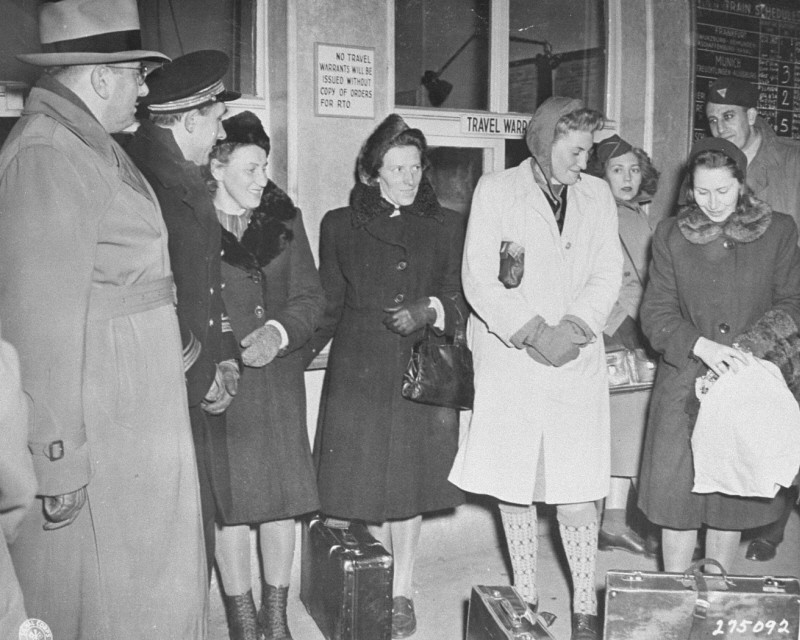Four Polish women arrive at the Nuremberg train station to serve as prosecution witnesses at the Doctors Trial. [LCID: 43033]