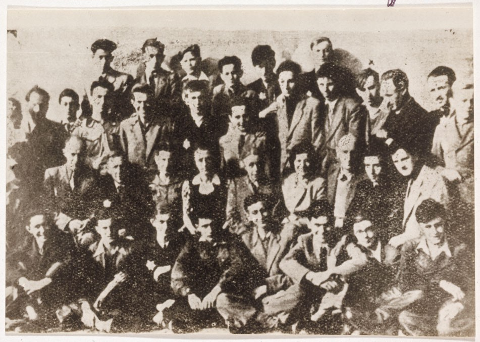 """<p>Group portrait of teenage boys in the Lodz ghetto. <a href=""""/narrative/10663/en"""">Dawid Sierakowiak</a>is in the 3rd row, 4th from right.</p> <p>Dawid kept a diary from before the war where he meticulously noted not only events but also his own feelings, moods, and opinions. Dawid was an avid reader and an excellent observer.</p>"""