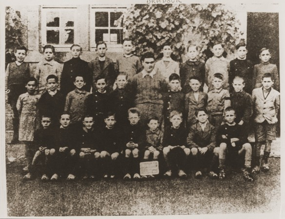 "<p>A class of boys from the school in <a href=""/narrative/11405"">Oradour</a>. All of the people pictured here were killed by the SS during the June 10, 1944, massacre. Oradour-sur-Glane, France, photograph taken between 1940 and June 1944.</p>"