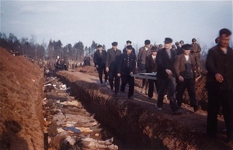 German civilians from the town of Nordhausen carry the bodies of prisoners found in the Nordhausen concentration camp to mass graves ... [LCID: 83927]