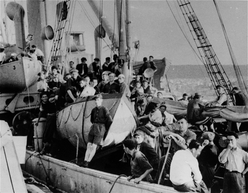 "<p>Jewish refugees on board the <a href=""/narrative/7475"">Aliyah Bet</a> (""illegal"" immigration) ship <em>Atrato</em>. The ship was caught by the British off the coast of Jaffa, Palestine, and escorted to Haifa port. July 17, 1939.</p>"