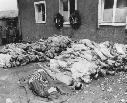 The bodies of former prisoners are stacked outside the crematorium in the newly liberated Buchenwald concentration camp. [LCID: 74608]